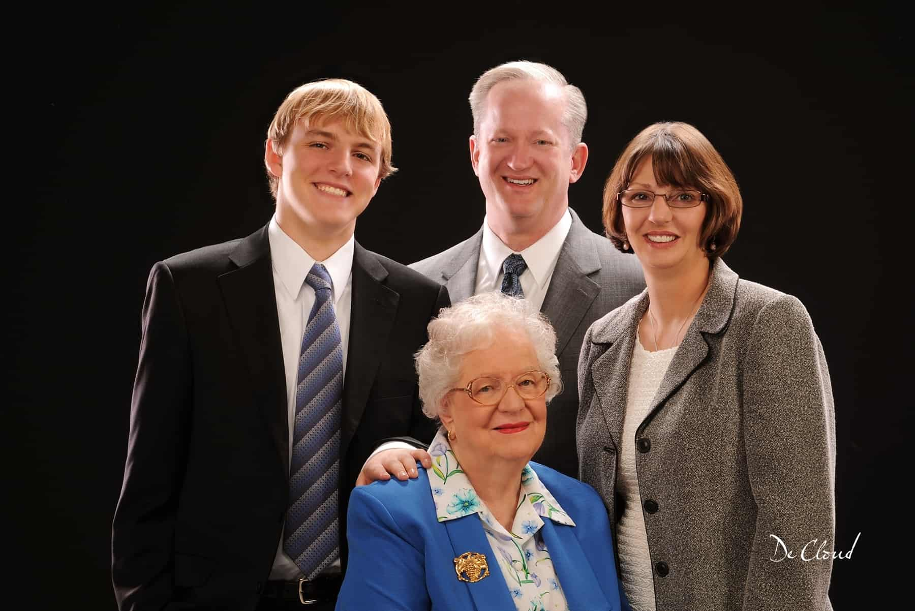 family photo with a father and mother, son, and grandmother